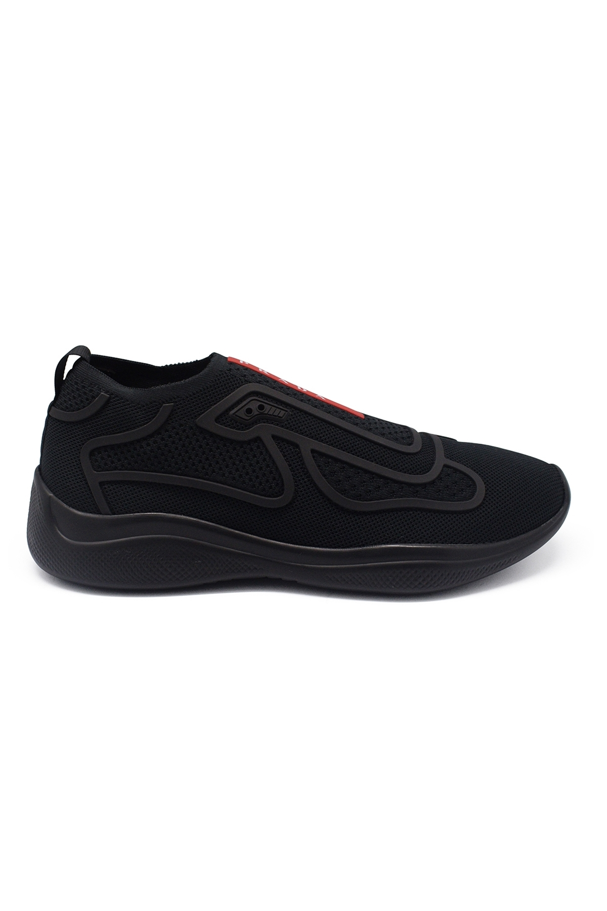 Prada slip-on black sneakers in stretched jersey with red and white Prada logo on the front
