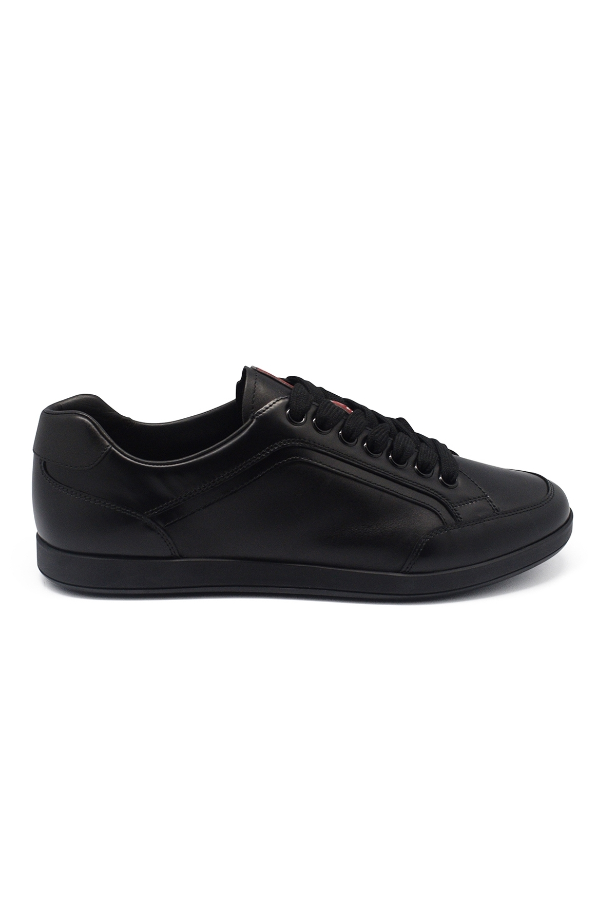 Prada black lace-up sneakers in leather with white and red Prada logo on the tongue