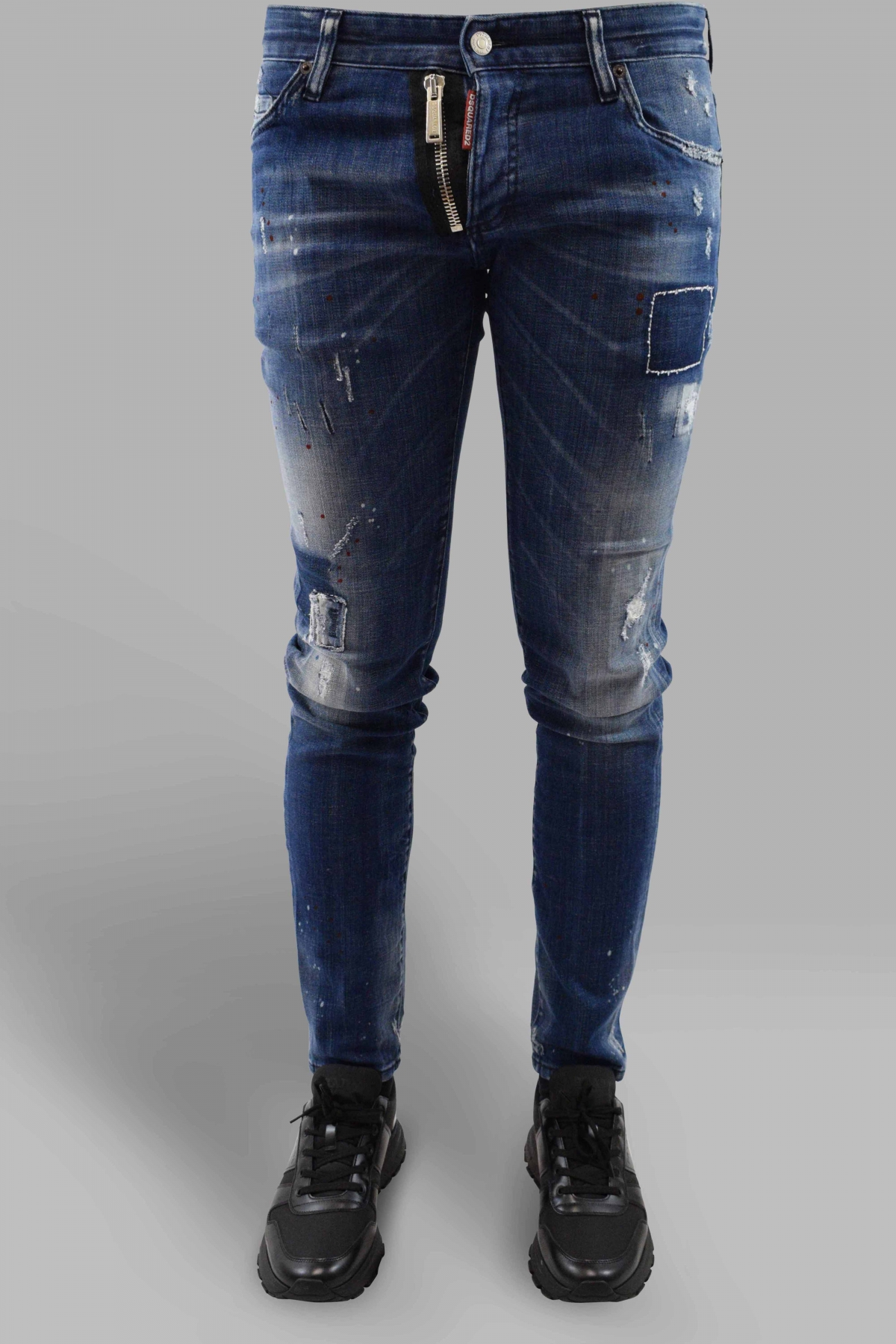 Dsquared2 blue Cool Guy jean with red paint stains, patches, zip and button closure