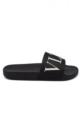Valentino flip flops in black rubber with VLTN logo at the front