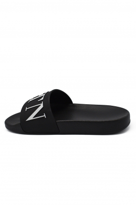 Claquettes Valentino en caoutchouc noir avec logo VLTN à l'avant
