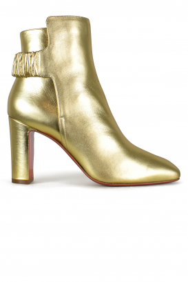 Ecuyera Louboutin ankle boots in golden leather.