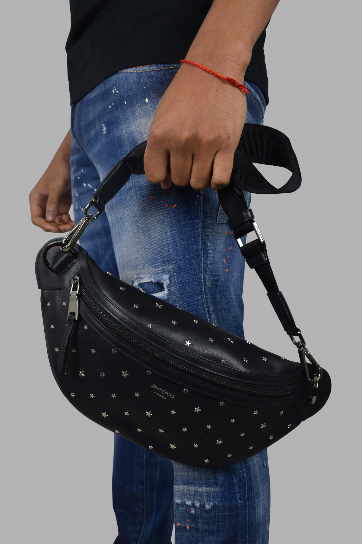 Jimmy Choo belt bag in black leather.
