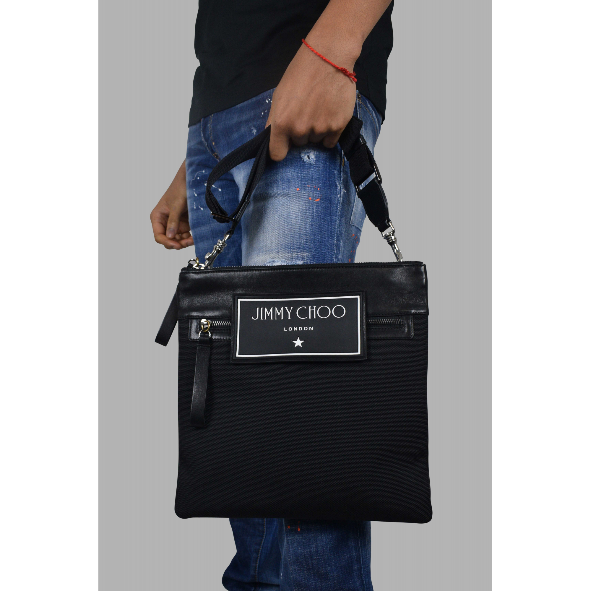 Jimmy Choo messenger bag in black leather and fabric.