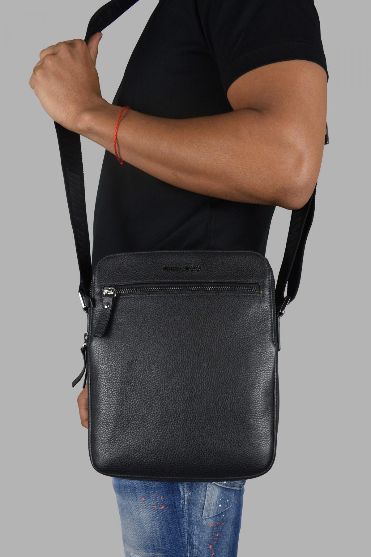 Jimmy Choo messenger bag in black leather.