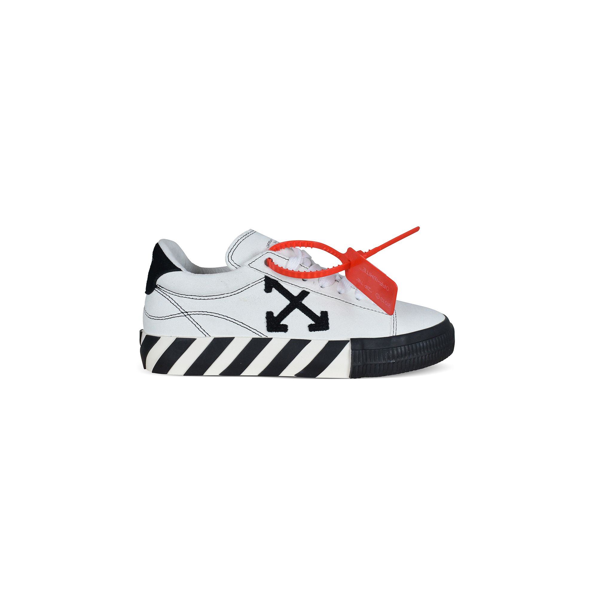 Low Vulcanized Off-White sneakers in white suede with black stitching.