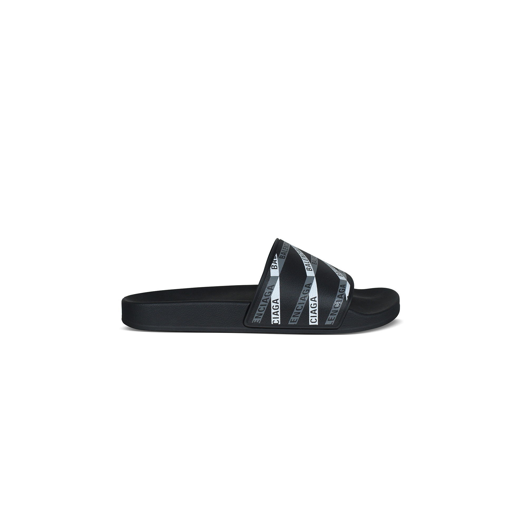 Black Balenciaga slides.