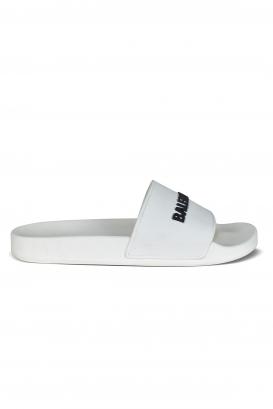 White Balenciaga slides.