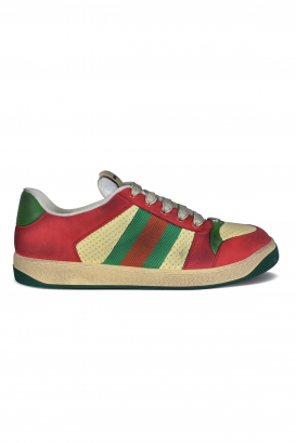Gucci Screener sneakers treated for a vintage worn effect.