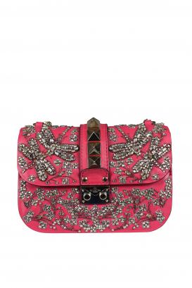 Valentino Garavani Rockstud Lock bag in fuchsia leather.