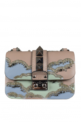 Valentino Garavani Rockstud Lock bag in pink leather.