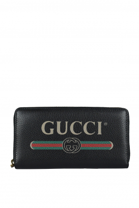 Gucci wallet in black leather with logo.