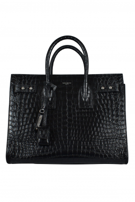 Saint Laurent black handbag in shiny crocodile-embossed leather.