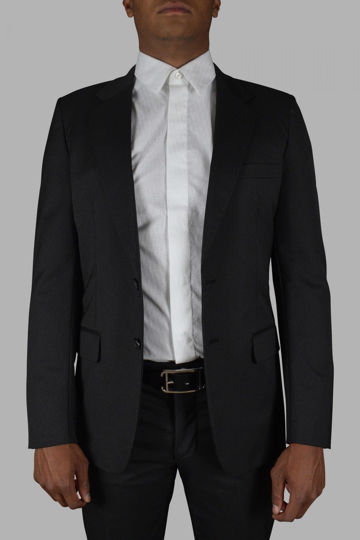 Prada two-piece gray suit with fine white stripes.