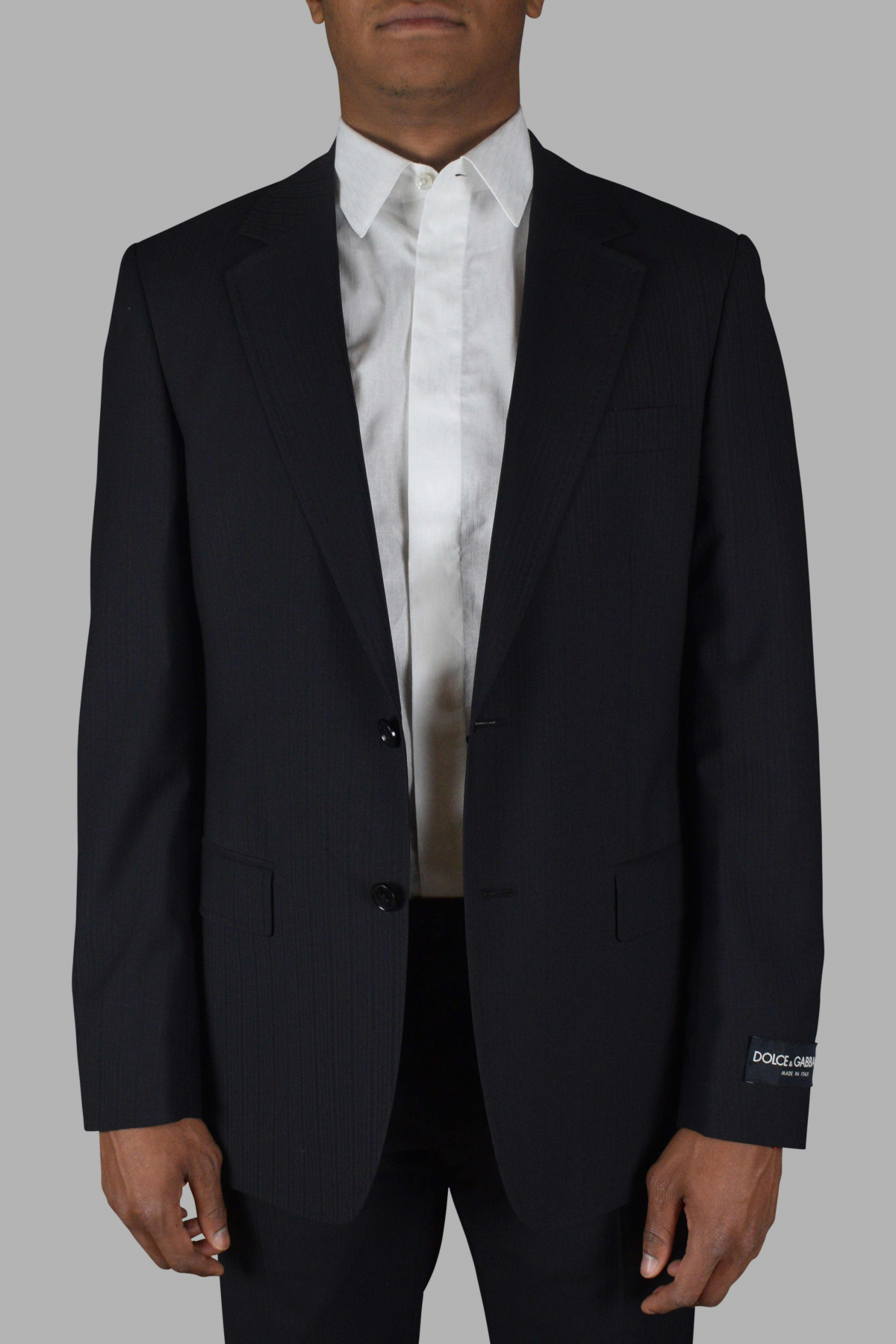 Black two-piece suit from Dolce & Gabanna with tone-on-tone stripes.