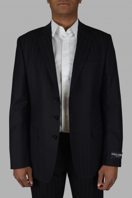 Black two-piece suit from Dolce & Gabbana with a herringbone pattern.