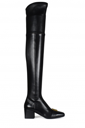 Balmain model Rosalyn thigh-high boots in black leather.