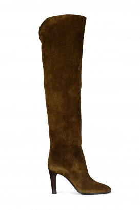 Saint Laurent model Jane thigh-high boots in brown suede.