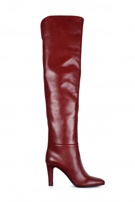 Saint Laurent model Jane thigh-high boots in smooth red leather.